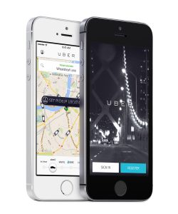 Varna Bulgaria - May 26 2015: Uber app startup page and Uber search cars map on the angled front view white and black Apple iPhones 5s. Isolated on white background.