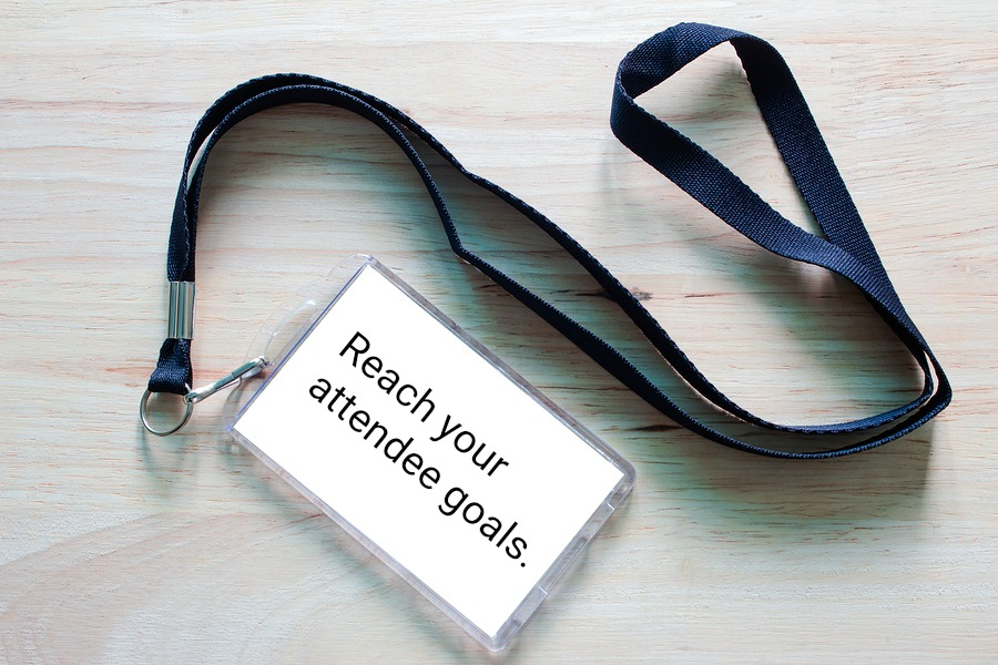 "Event badge lanyard printed with ""reach your attendee goals"""
